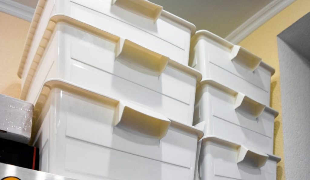 stack of plastic storage boxes