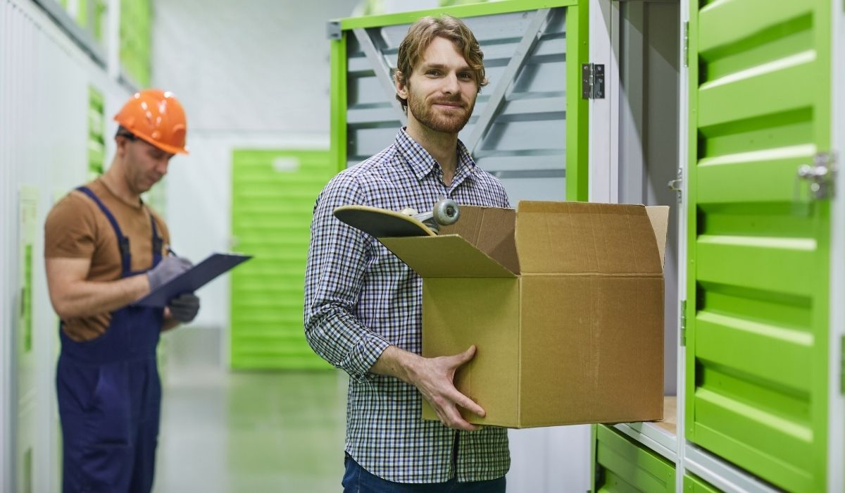 man renting a unit in a storage facility