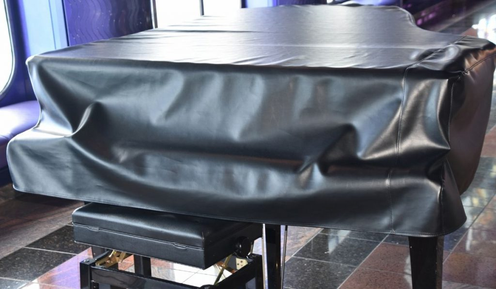 piano with leather cover